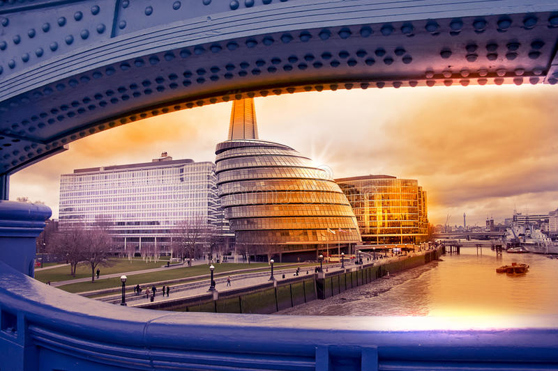 Cityscape of London with city hall. View from Tower Bridge at sunset on a vintage warm color filtered look stock photo