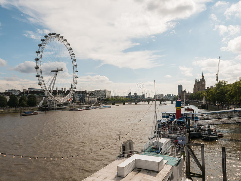 Cityscape with London Eye and Westminster on Thames River stock photos
