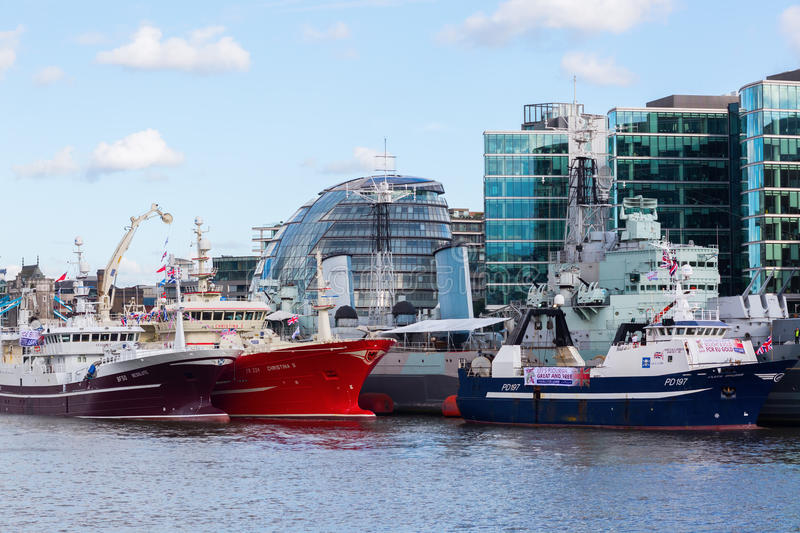 Cityscape of London with Thames, HMS Belfast and City Hall royalty free stock image