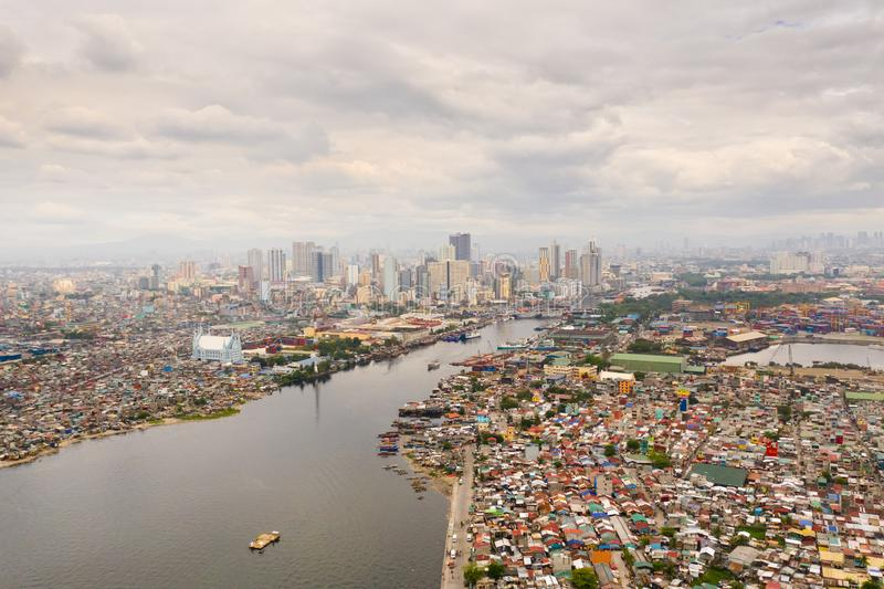 Cityscape Manila. Residential areas and business center in the city, top view. Big port city. Contrast social strata. Cityscape Manila. Residential areas and royalty free stock photography