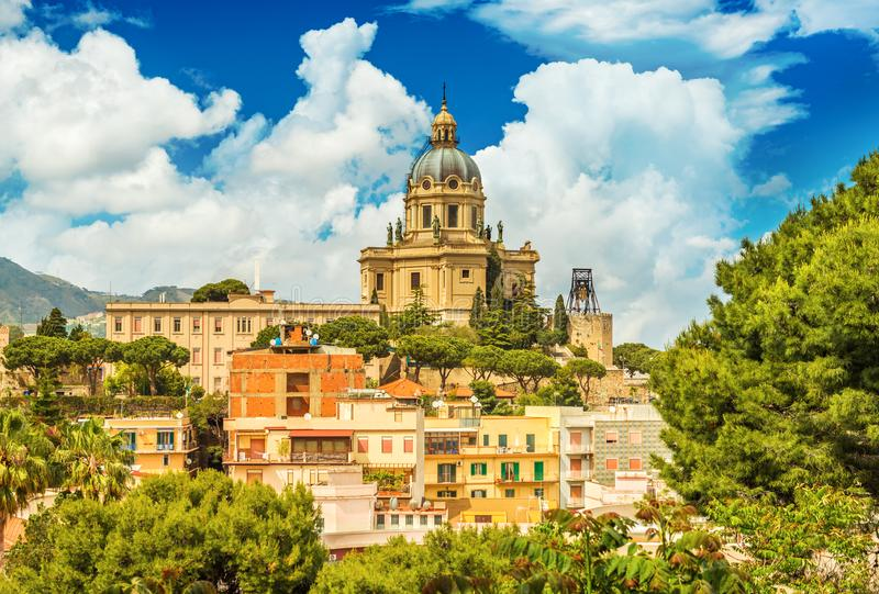 Cityscape of Messina with Cathedral on the top of the hill, colored houses and beautiful clouds with a blue sky, Sicily, Italy stock image