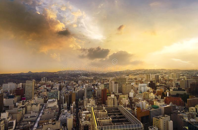 Cityscape of miyagi, city aerial skyscraper view of office building and downtown of sendia with sunset rays of light shining down stock photos
