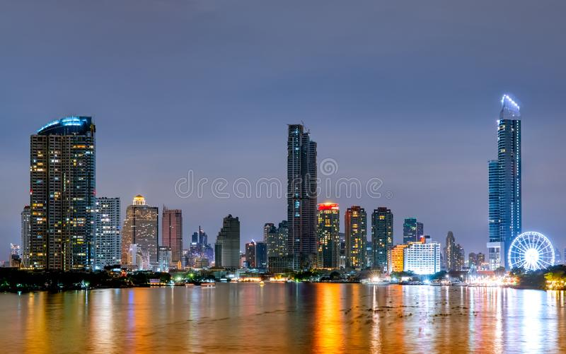 Cityscape of modern building near the river in the night. Modern architecture office building. Skyscraper with evening sky. Black. And white tone picture. Night royalty free stock image
