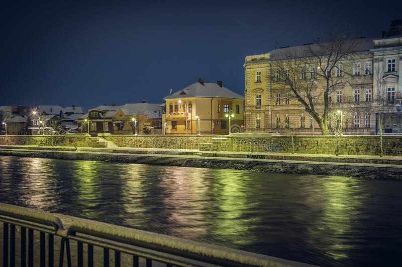 Cityscape of Nis and Nisava river in a winter nigh. Architecture and nature background royalty free stock images