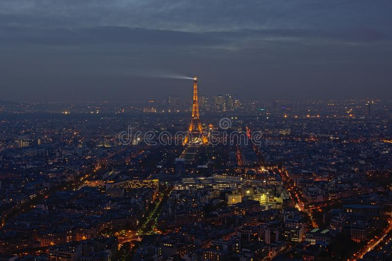 Cityscape of Paris at night, with illuminated Eiffel tower royalty free stock photos