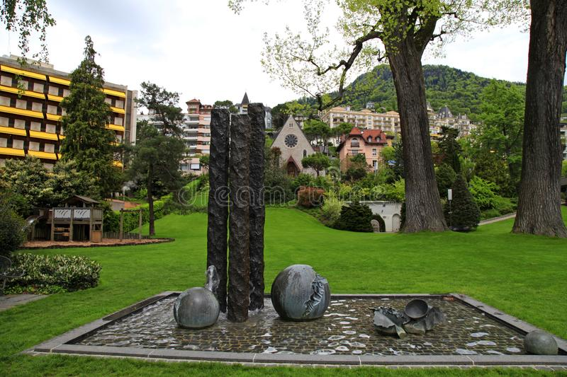 Cityscape with park and fountain in Montreux, Switzerland. Cityscape with park and fountain in Montreux on Geneva Lake embankment, Vaud canton, Switzerland stock photo