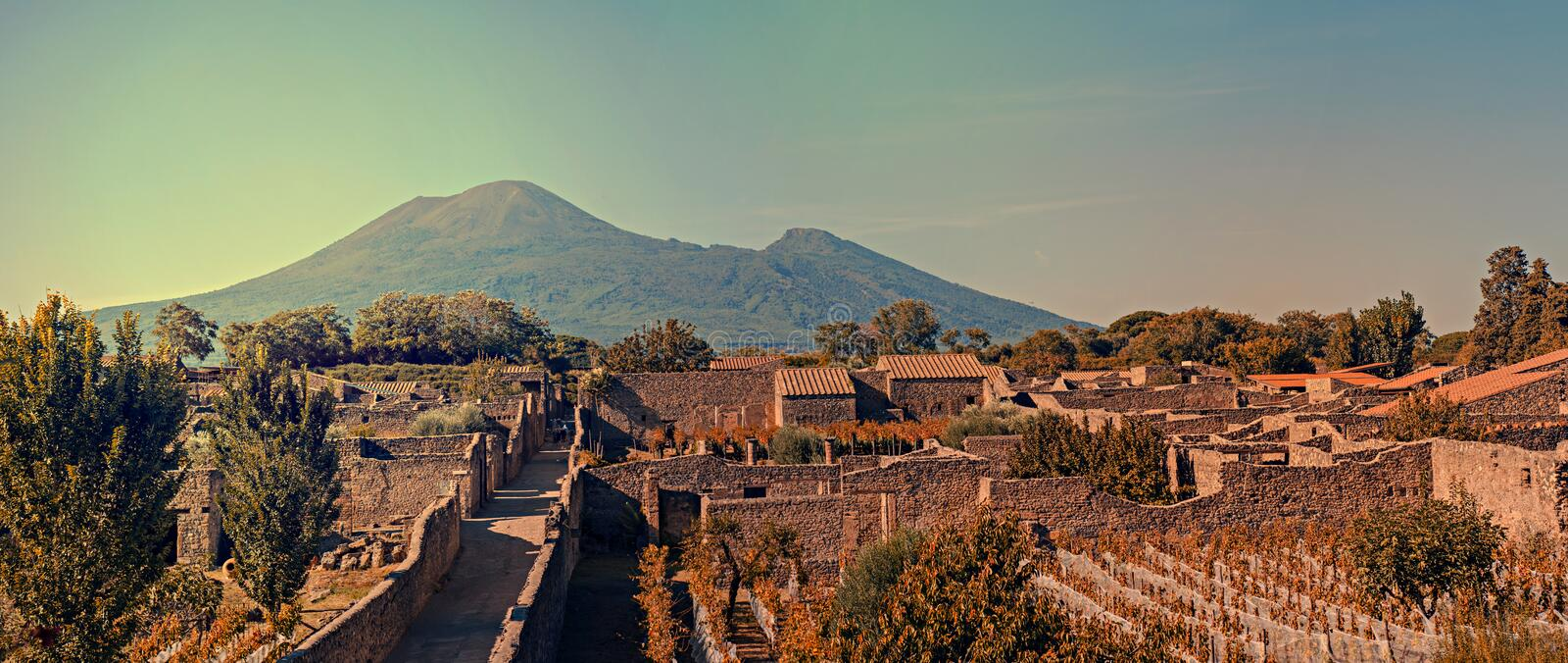 Cityscape of Pompeii with Mt Vesuvius at sunset royalty free stock images