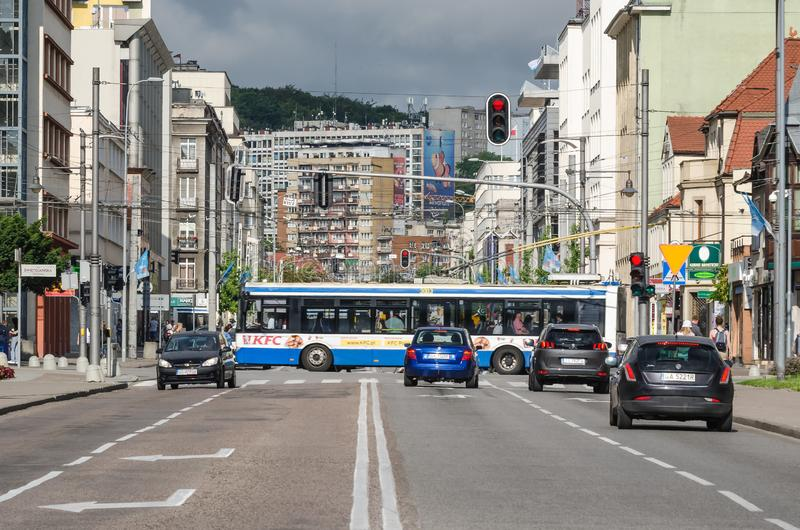 CITYSCAPE. Public transport vehicles and cars on the street in the city center royalty free stock photo