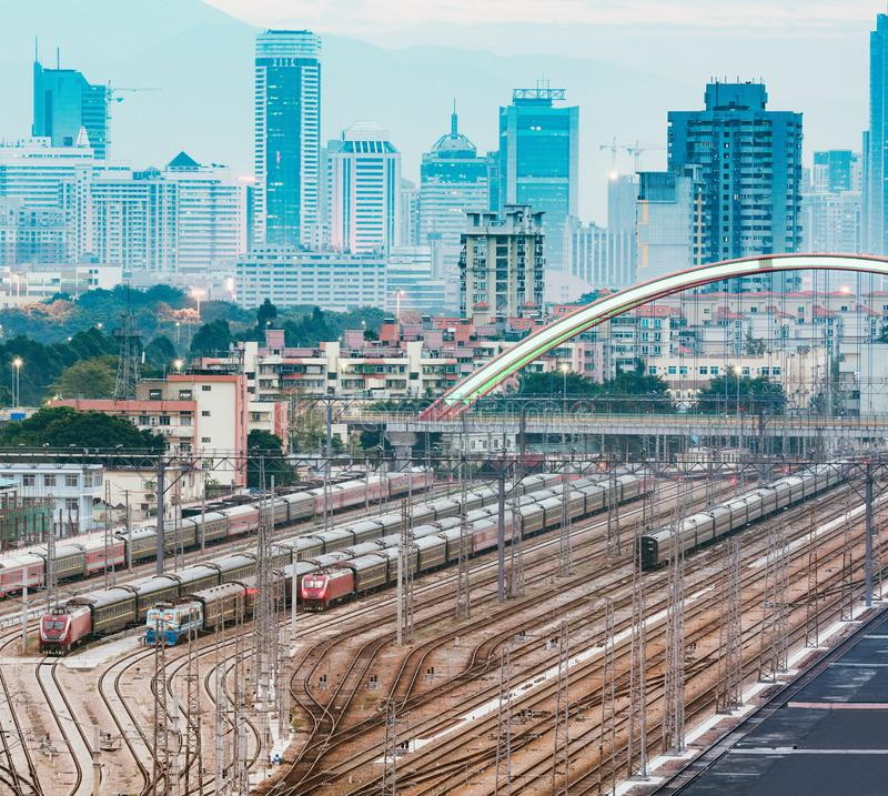Cityscape and railway station at evening time stock photos