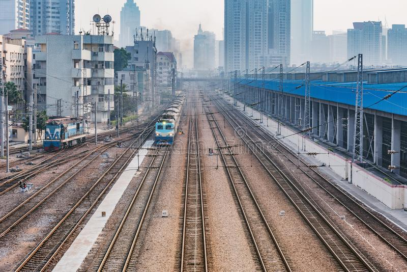 Cityscape and railway station at evening time stock images