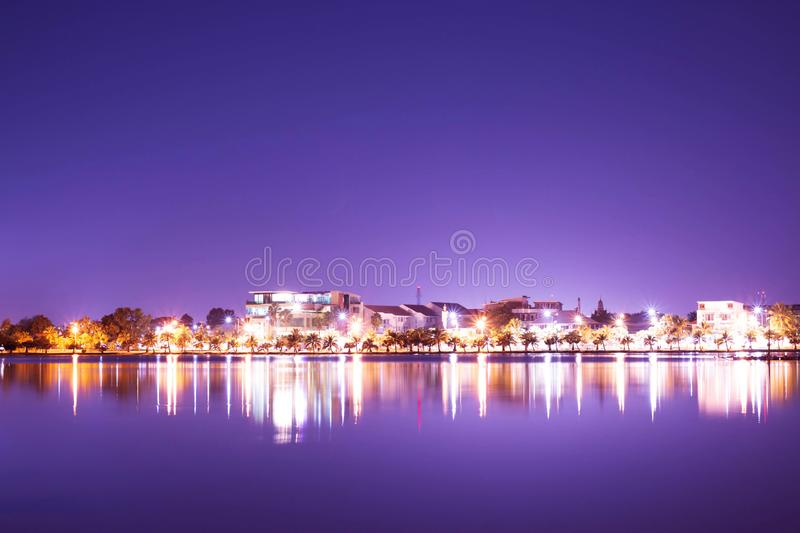 Cityscape and reflection at night. Cityscape and reflection on lake at night royalty free stock photography