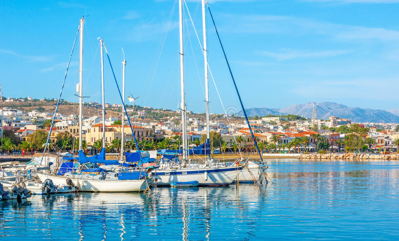 The cityscape of Rethymno. The the view from the new port on the coastline of Rethymno with the modern districts on the hilly area, Crete, Greece royalty free stock image