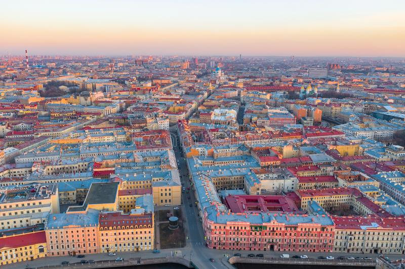 Cityscape of Saint-Petersburg. Aerial view to the southern part of the city from the center, Trinity Cathedral. Evening sunset stock image