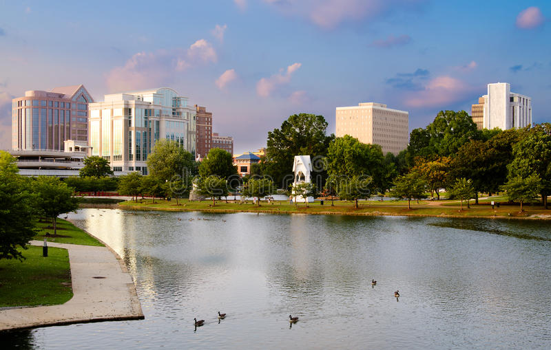 Cityscape scene of downtown Huntsville, Alabama. From Big Spring Park at sunset royalty free stock photos