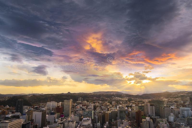 Cityscape of sendai city aerial skyscraper view of office building and downtown of sendia with sunset rays of light shining down. Pass clouds background. Japan stock images