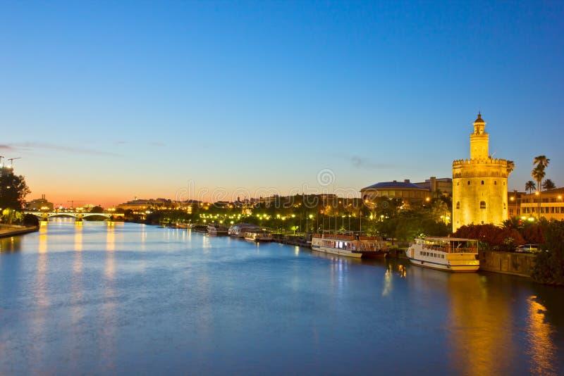 Cityscape of Sevilla at night, Spain. Cityscape with river of Sevilla at night, Spain stock photo