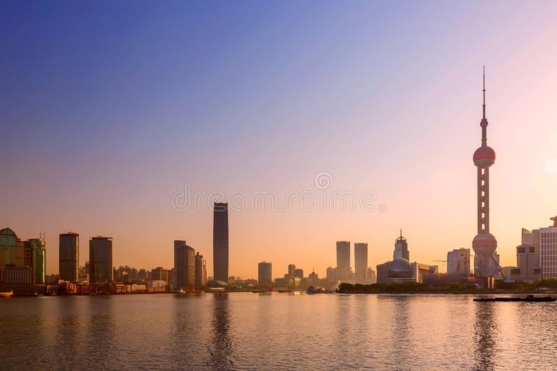 Cityscape of Shanghai at sunrise. Panoramic view of Pudong business district skyline from the Bund royalty free stock image