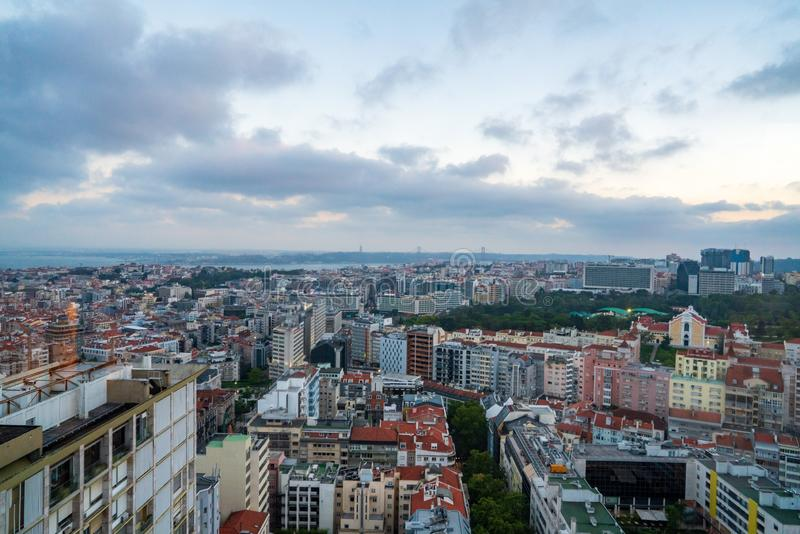 Cityscape shot of Lisbon in the evening dusk hours royalty free stock photos