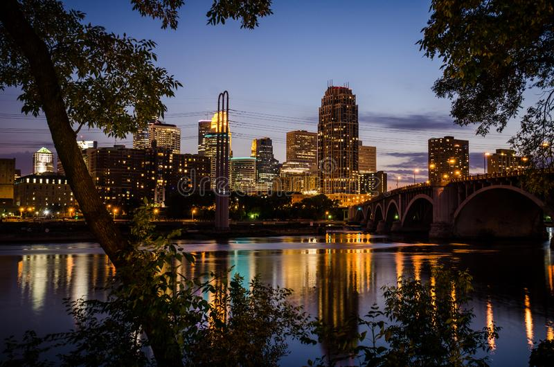 Cityscape skyline of Downtown Minneapolis Minnesota in the Twin Cities Metro area at night stock image