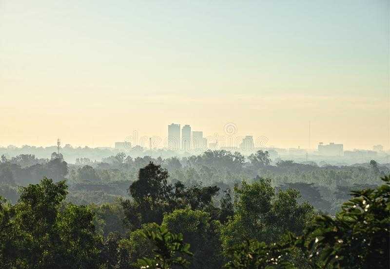Cityscape at Sunrise with Morning from airport : Khon Kaen, Thailand. Cityscape at Sunrise with Morning Mist from airport : Khon Kaen, Thailand royalty free stock photos