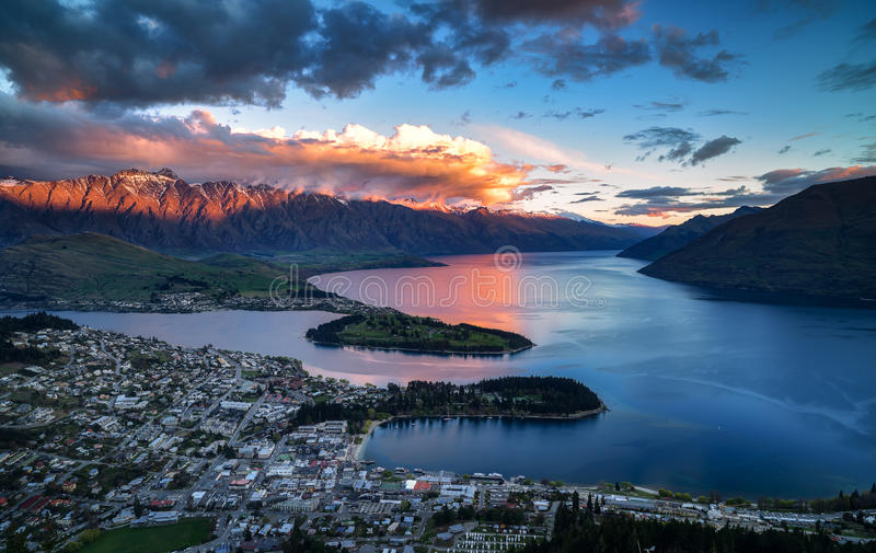 Cityscape, sunset of queenstown with lake Wakatipu from the skyline, south island, new zealand royalty free stock image
