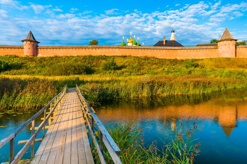 Cityscape of Suzdal, famous city in The Golden Ring of Russia. Wooden bridge across the river. Old Russian architecture. Suzdal Kremlin royalty free stock photo