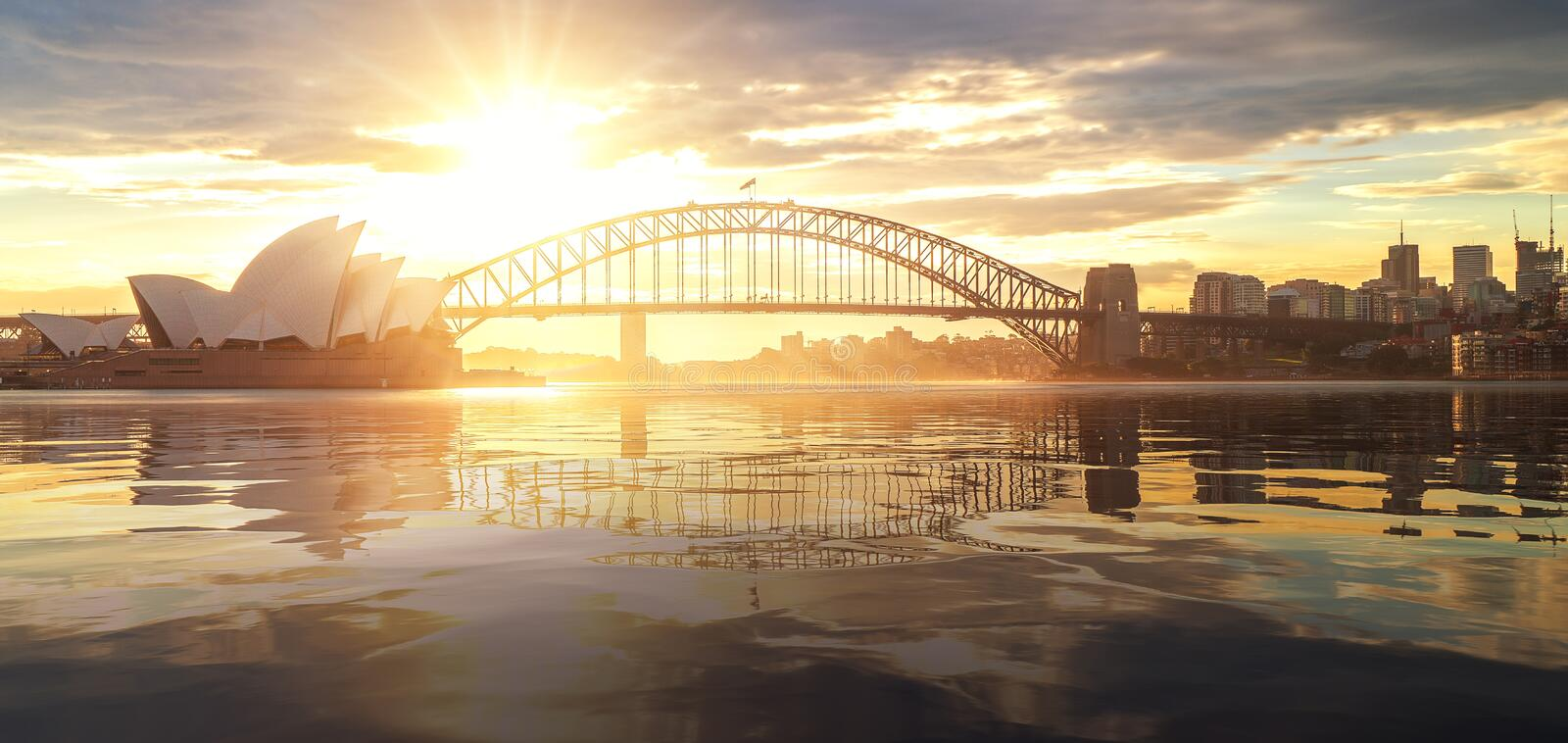 Cityscape of Sysney harbour and bridge with morning sunrise moment. And boat in the sea, New south wales, Australia, this immage can use for travel, trorist and royalty free stock photography
