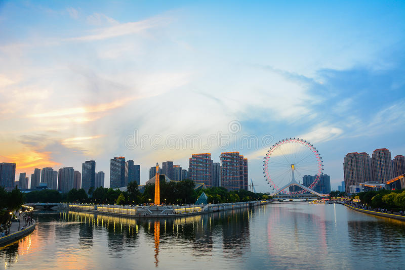 Cityscape of Tianjin ferris wheel,Tianjin eyes in twilight time royalty free stock photography