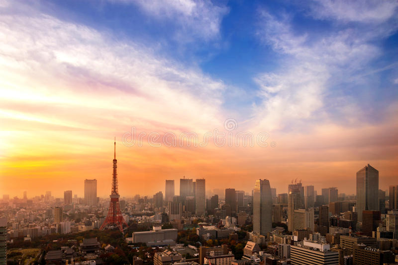 Cityscape of Tokyo, city aerial skyscraper view of office building and downtown of tokyo with sunset / sun rise background. Japan stock images