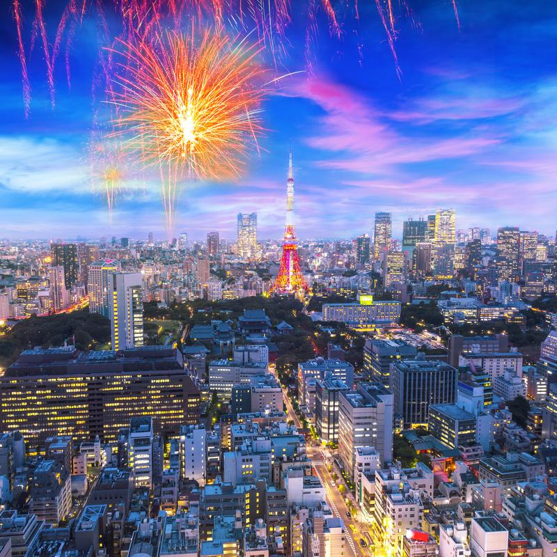 Cityscape of Tokyo, city with firework display for celebration,  aerial skyscraper view of office building and downtown and street stock photos