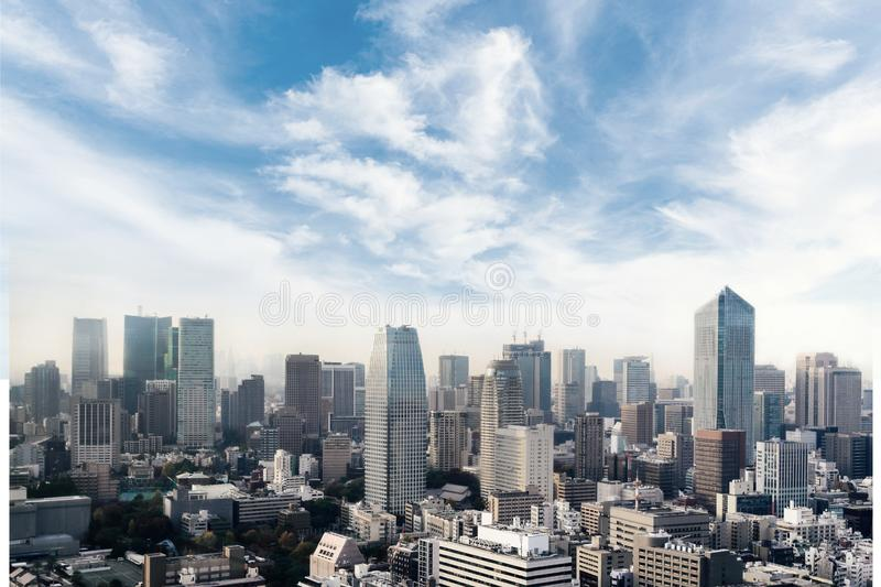 Cityscape of Tokyo city, japan. Aerial skyscraper view of office building and downtown of tokyo with sunset/ sun rise background. royalty free stock image