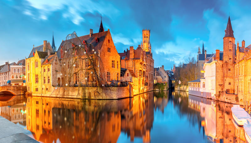 Cityscape with a tower Belfort from Rozenhoedkaai in Bruges at s. Scenic cityscape with a medieval fairytale town and tower Belfort from the quay Rosary royalty free stock image
