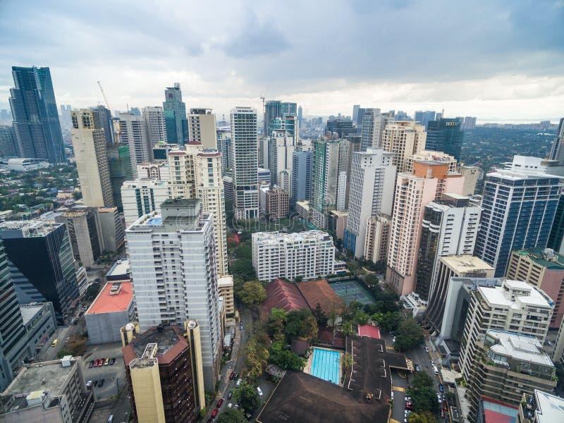 Cityscape van Manilla, Makati-Stad met Bedrijfsgebouwen en Bewolkte Hemel filippijnen Wolkenkrabbers op achtergrond royalty-vrije stock foto's