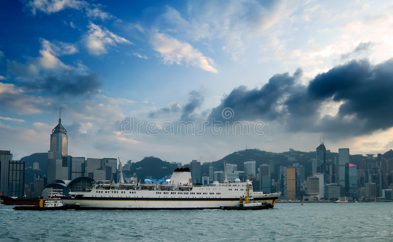 Cityscape of Victoria harbor with big ship royalty free stock photo