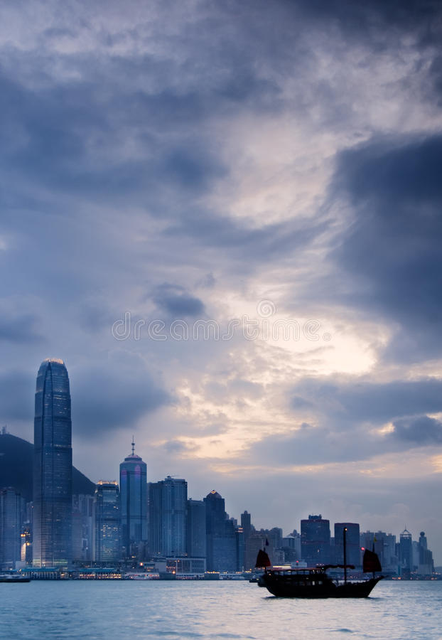 Cityscape of Victoria harbor with old boat royalty free stock image
