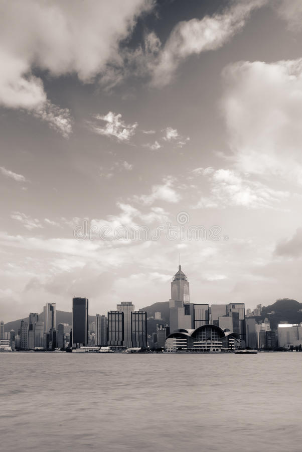 Cityscape of Victoria harbor with white cloud stock photos