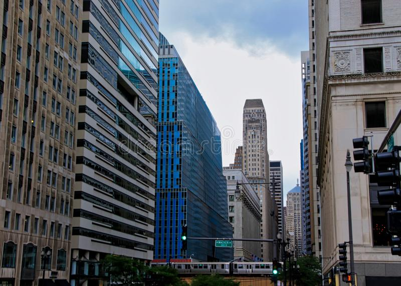Cityscape view of Chicago`s elevated train and track on Lake and LaSalle Streets in Chicago Loop. Cityscape view of Chicago`s elevated green line train and stock photo