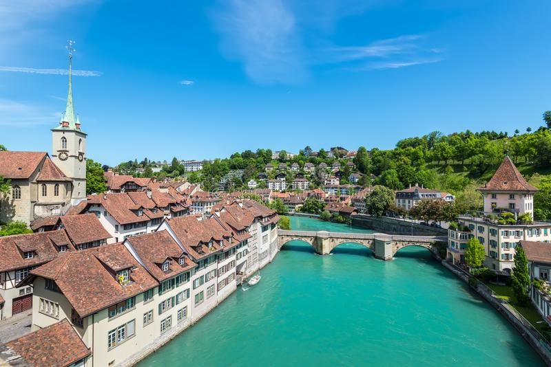 View of the Old City of Bern with the bridge Untertorbryukke over Aare river, Berne, Switzerland. Cityscape view on the old town with river and bridge in Bern royalty free stock image