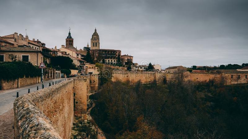 Cityscape view of Segovia skyline with Cathedral and City Walls - Segovia, Castile and Leon, Spain.  stock photo