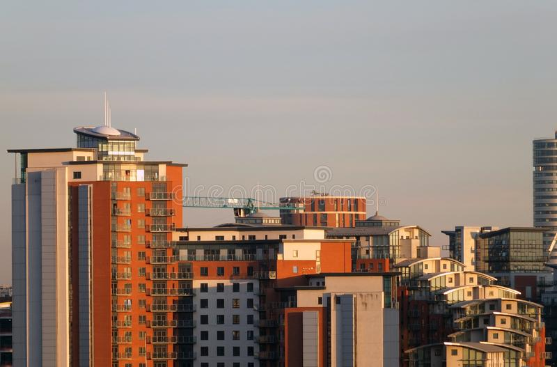 a cityscape view of tall modern residential developments in leeds city centre with a construction crane working on new stock photo