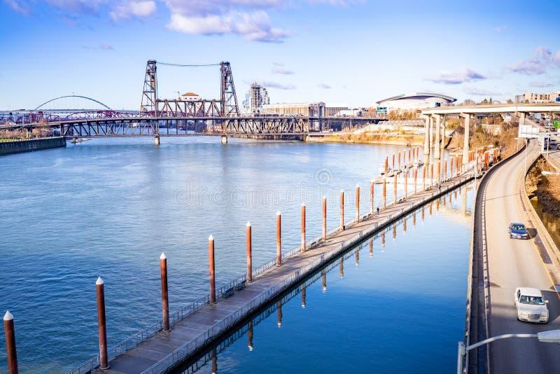 Cityscape Willamette river and Steel Bridge, view from Burnside. Portland, US - Dec 21, 2017 : Cityscape Willamette river and Steel Bridge, view from Burnside royalty free stock photography