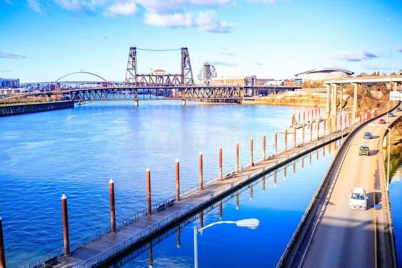 Cityscape Willamette river and Steel Bridge, view from Burnside. Portland, US - Dec 21, 2017 : Cityscape Willamette river and Steel Bridge, view from Burnside royalty free stock photos