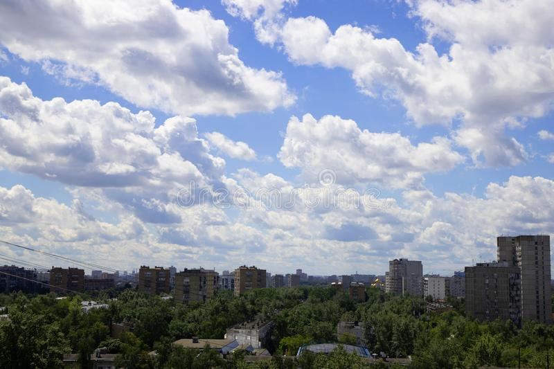 Cityscape from the window of a high-rise building in a residential area with a beautiful sky in white, fluffy clouds. The view stock photo