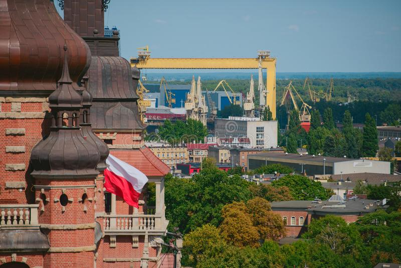 Cityscape with yellow cranes in the background stock photos
