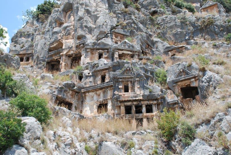 Ciudad antigua tallada en la roca en Turquía cerca de Antalya fotografía de archivo libre de regalías