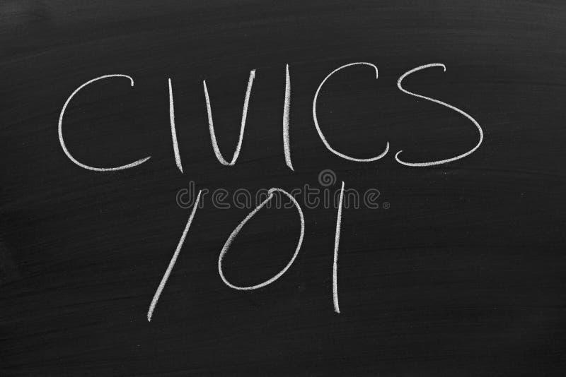 Civics 101 On A Blackboard. The words `Civics 101` on a blackboard in chalk royalty free stock image