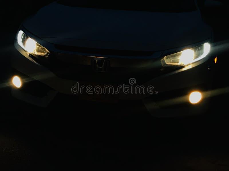 Civics front head lights. Lighting in night stock photos