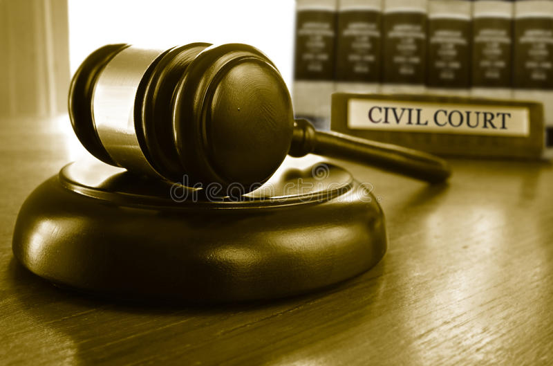 Civil court gavel. Judge`s Civil Court gavel on a desk with law books royalty free stock photos