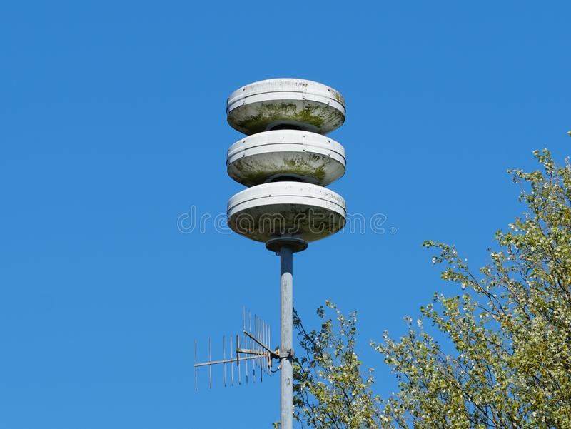 Civil defense siren installation in the Netherlands. Used to provide emergency population warning of approaching danger. The Netherlands tests its air-raid royalty free stock image