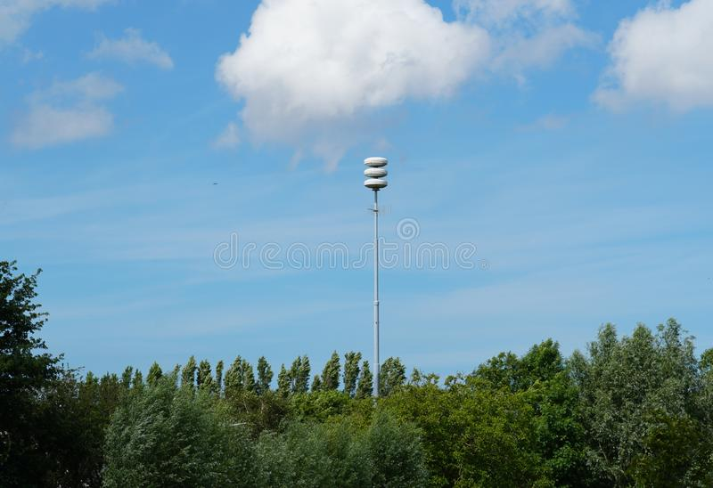 Civil defense siren installation in the Netherlands. Used to provide emergency population warning of approaching danger. The Netherlands tests its air-raid stock photos